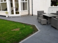 Finished anthracite porcelain patio with garden furniture
