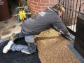 ASP worker installing rose resin driveway