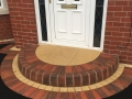 Doorstep design on tarmac driveway