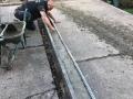 working on slate grey resin driveway