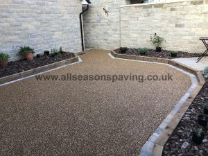 Resin bound patio in Lancaster, Lancashire showing flower beds